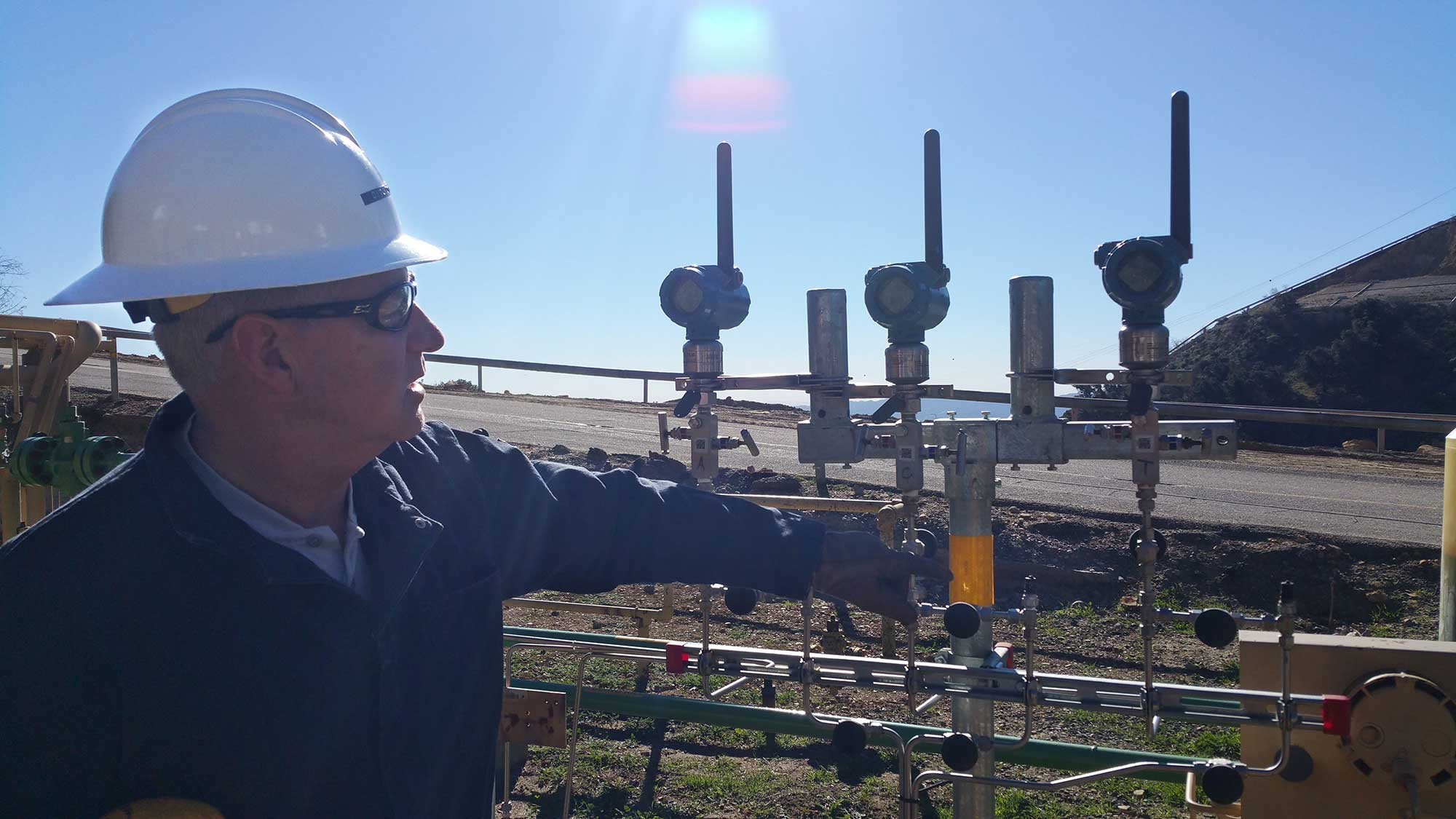 Technician viewing gauge readings at Aliso Canyon site
