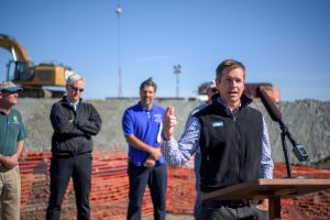 Curtis Knight, Executive Director, California Trout, speaks at the Wallace Weir media event. Yet another hazard to migratory salmon will disappear soon, when local, state, and federal officials finish building a permanent, fish-friendly weir in the Yolo Bypass four miles northeast of Woodland. The Wallace Weir Fish Rescue project will help prevent adult Sacramento River salmon from swimming into a drainage ditch that leads deep into farm fields where spawning is hopeless. By building a permanent barrier across the Knights Landing Ridge Cut, the agencies will be able to better control farm drainage releases to avoid attracting salmon. A new fish collection facility adjacent to the weir will allow the California Department of Fish and Wildlife to more effectively capture stray salmon and return them to the river to spawn. John Chacon / California Department of Water Resources, FOR EDITORIAL USE ONLY.