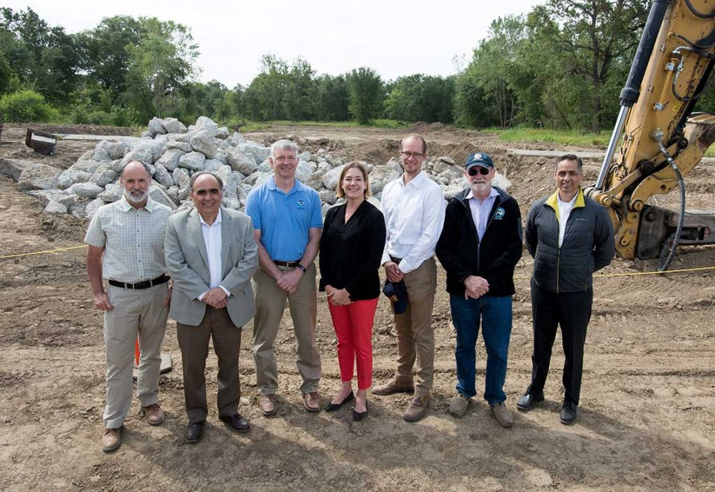 Representing a diverse group of varying interests, project partners come together at the Fremont Weir Groundbreaking Ceremony to celebrate a significant milestone for improved fish passage in the Yolo Bypass. From left to right John Cain, Director of Conservation for CA Flood Management, American Rivers Jim Provenza, Yolo County Supervisor Barry Thom, Regional Administrator, NOAA Fisheries Karla Nemeth, Director, Department of Water Resources Kris Tjernell, Deputy Director, Department of Water Resources John Laird, Secretary, California Natural Resources Agency David Murillo, Regional Director, U.S. Bureau of Reclamation