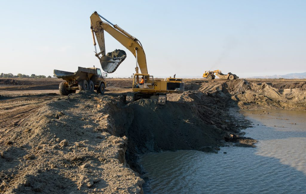 Construction equipment removes sand from a borrow pit to be placed at the Dutch Slough Tidal Marsh Restoration Project in the Sacramento-San Joaquin Delta implemented by the California Department of Water Resources. (Photo courtesy of the CA Department of Water Resources)